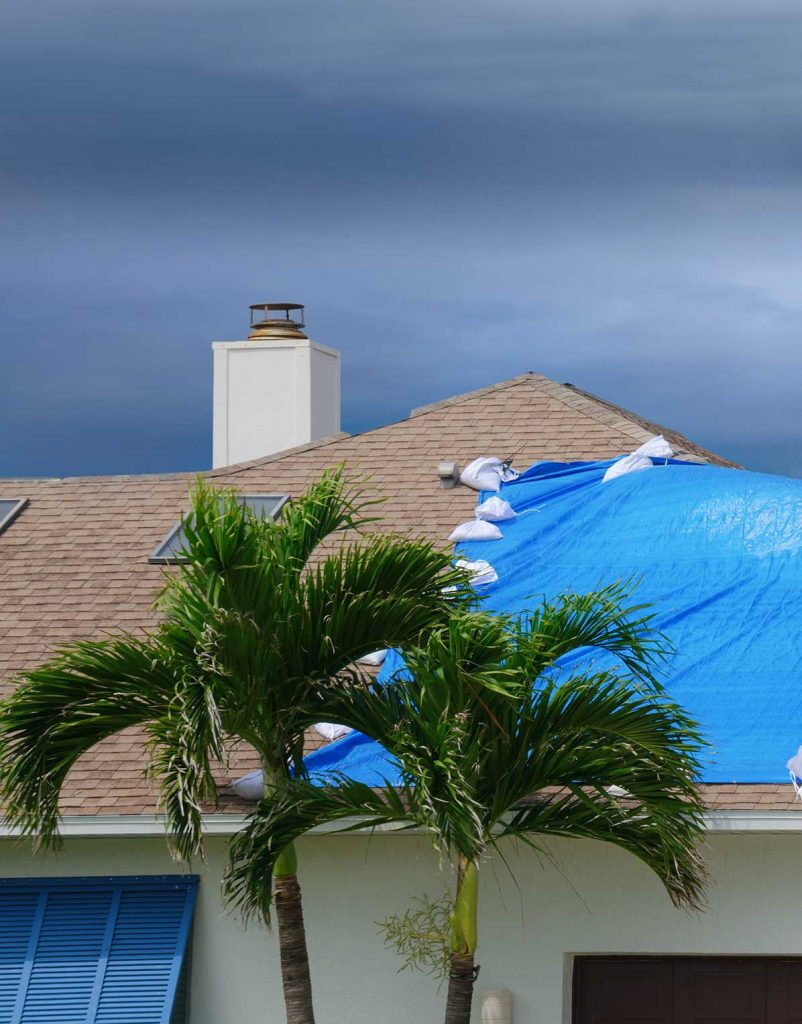 blue tarp over home roof