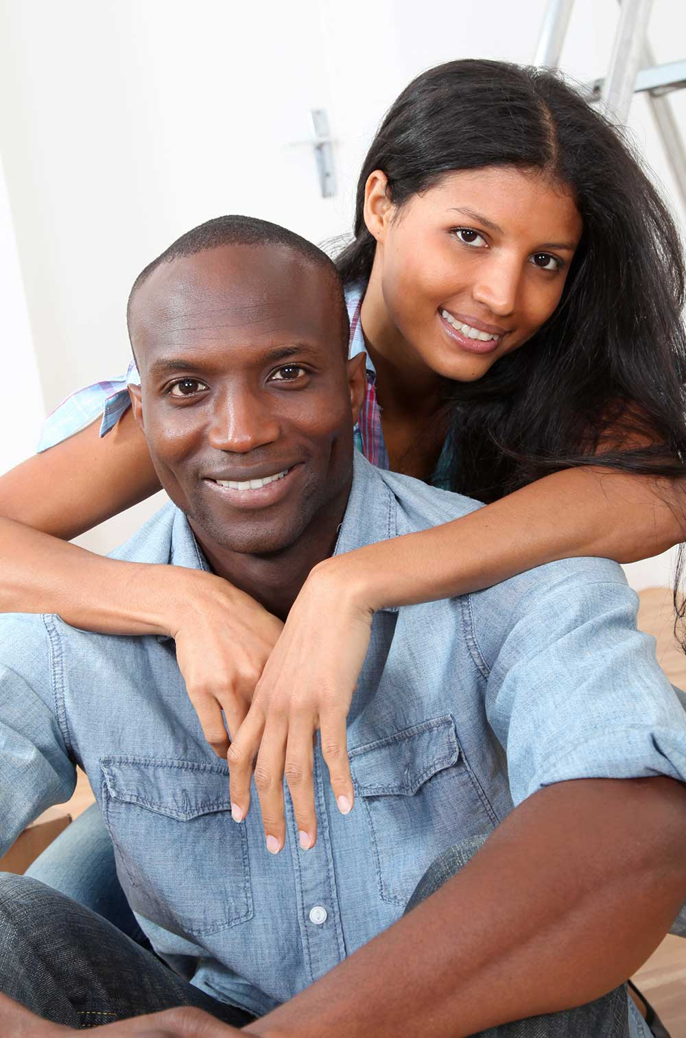 happy young African American homeowners